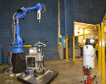 Robot Arm Aids in High Frequency Antenna Calibration Breakthrough